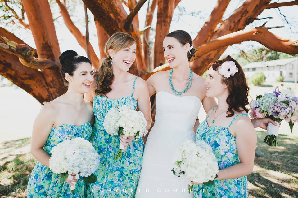 The bride and bridesmaids. Their bouquets were all white, with just one turquoise hydrangea.